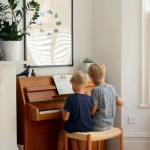 boys playing piano