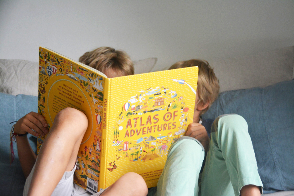 boys reading Atlas of Adventures