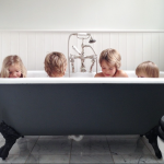 four kids in bath