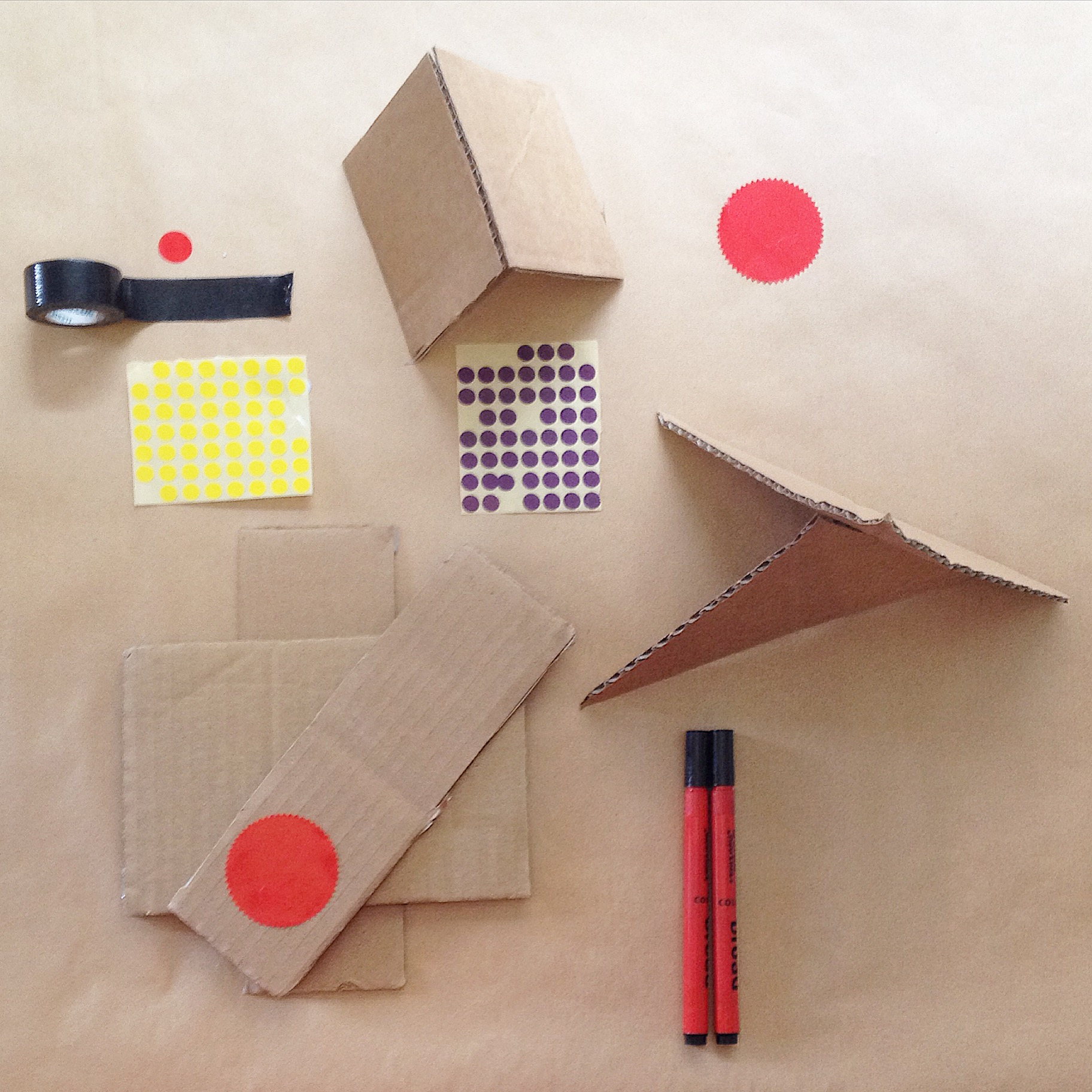 2. Cardboard, tape, stickers, pens