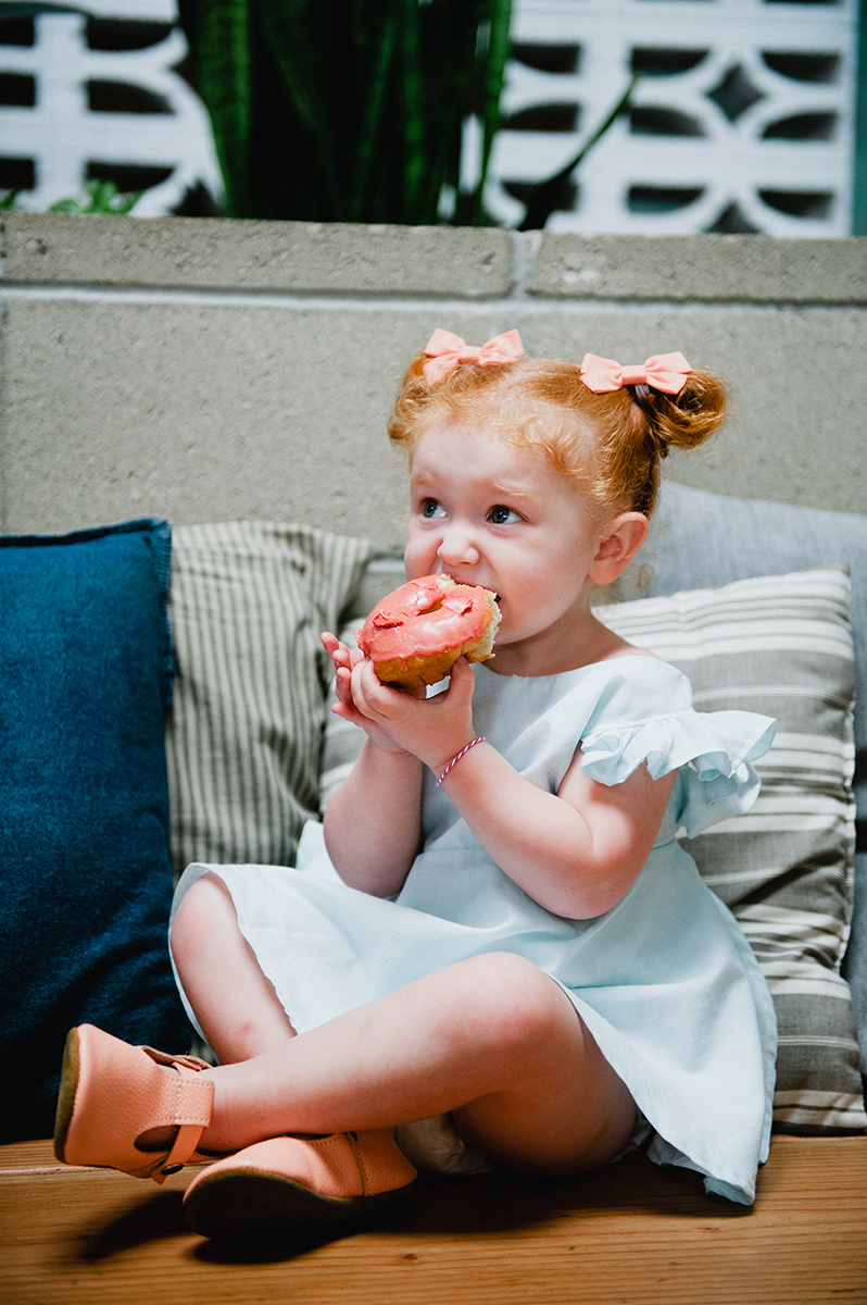 ShopUp cutie eating a donut