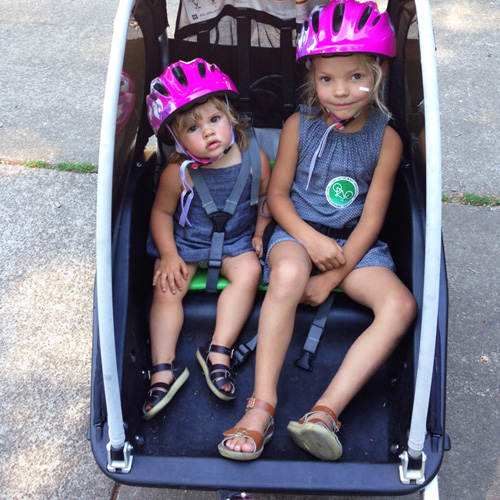 girls in bike trailer