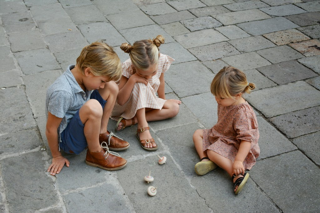kids playing with tops