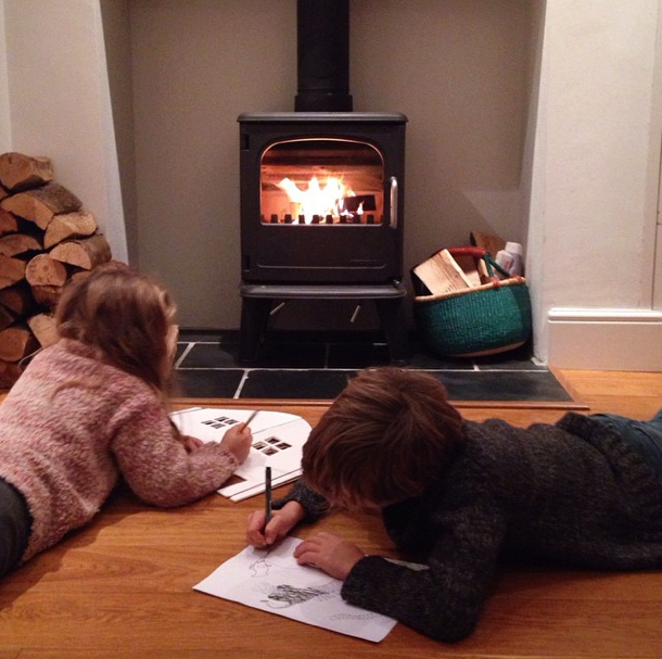 kids drawing in front of fire
