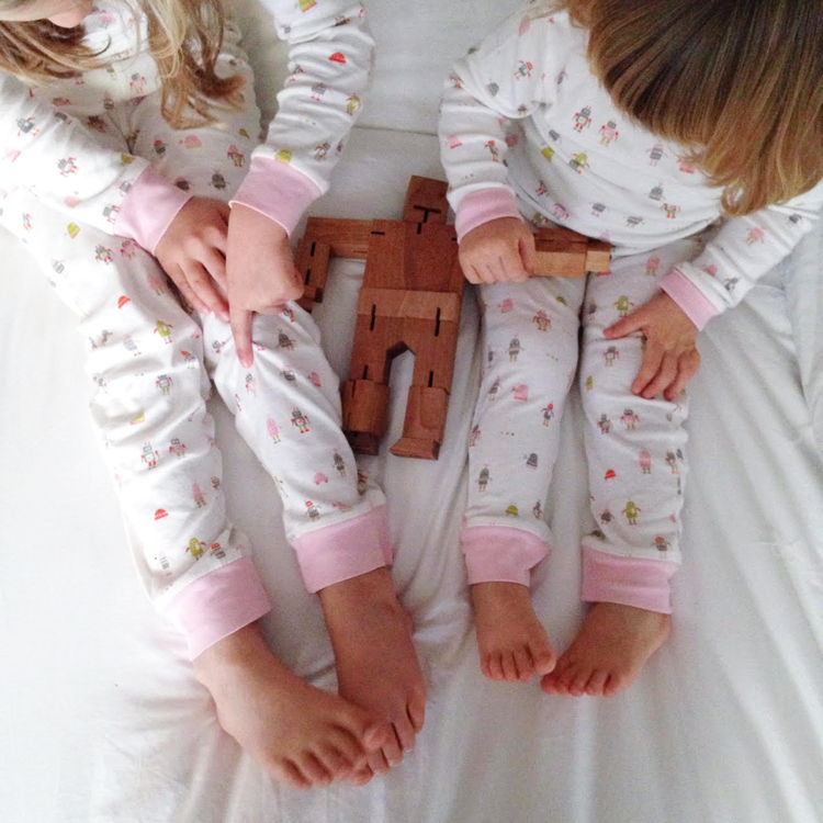Girls in Auggie robot pajamas