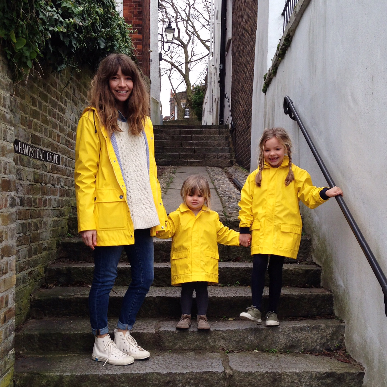 mother and daughter yellow raincoats