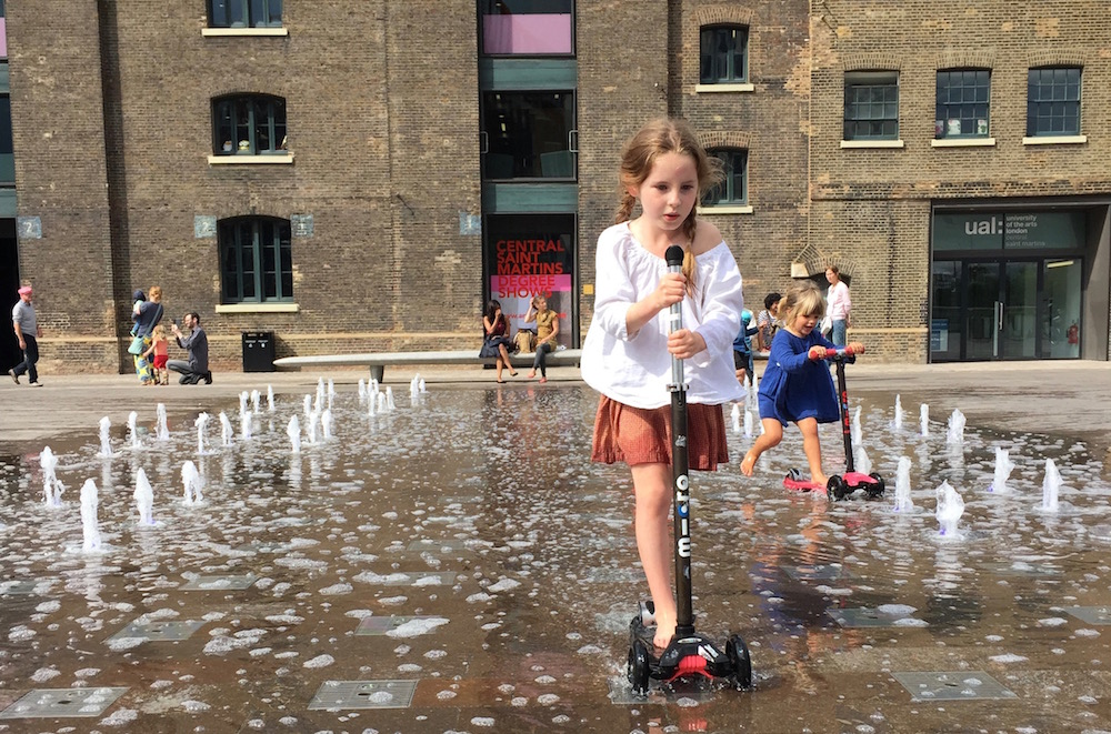 Sophie Marlow scooting in fountains