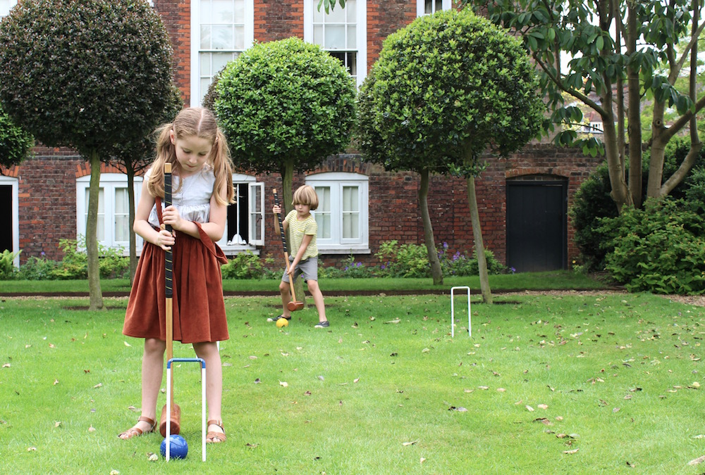 Playing croquet Fenton House lawn