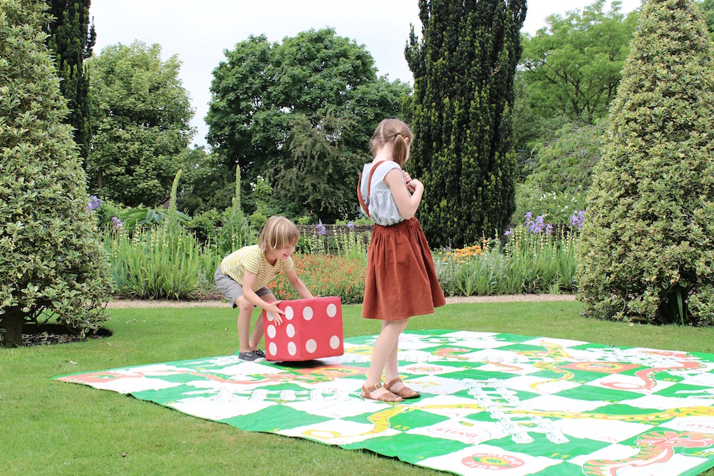 Playing snakes and ladders on Fenton House lawn