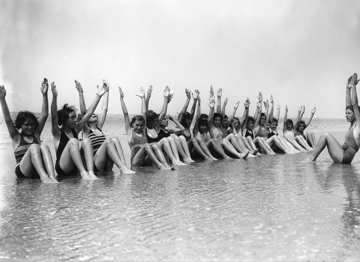 FRANCE - APRIL 22: Young ladies in the middle of a gymnastics session along the sea in Deauville on July 22, 1937. (Photo by Keystone-France/Gamma-Keystone via Getty Images)