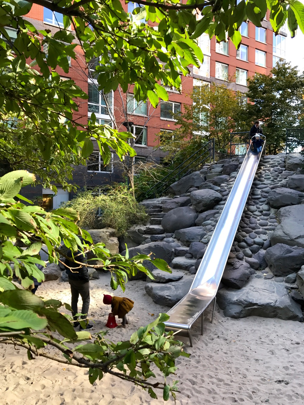 Teardrop Park slide and sand pit