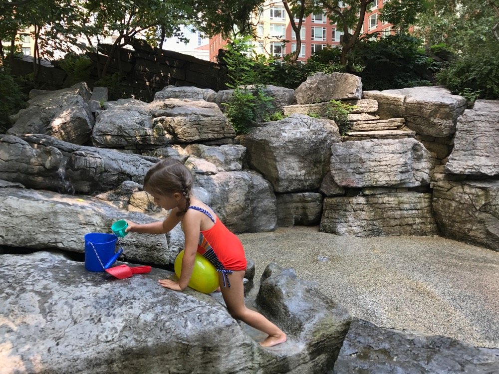 playing in the water at Teardrop Park
