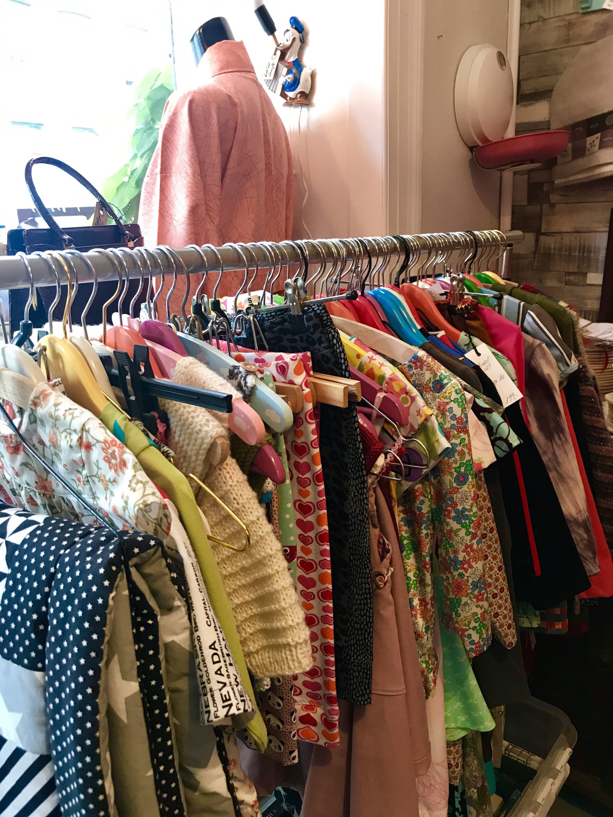 e67fa0eb9 Near the door is a rail hung with handmade children's clothing – smocks in  Liberty prints, little dresses and shirts in loud 60s fabric and tiny  sweaters, ...