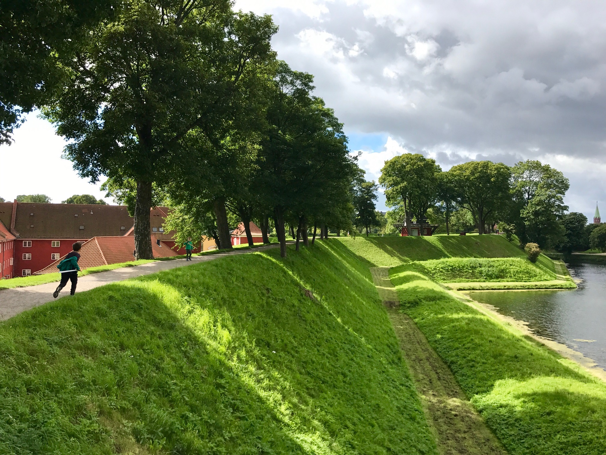 child-running-at-kastellet-copenhagen