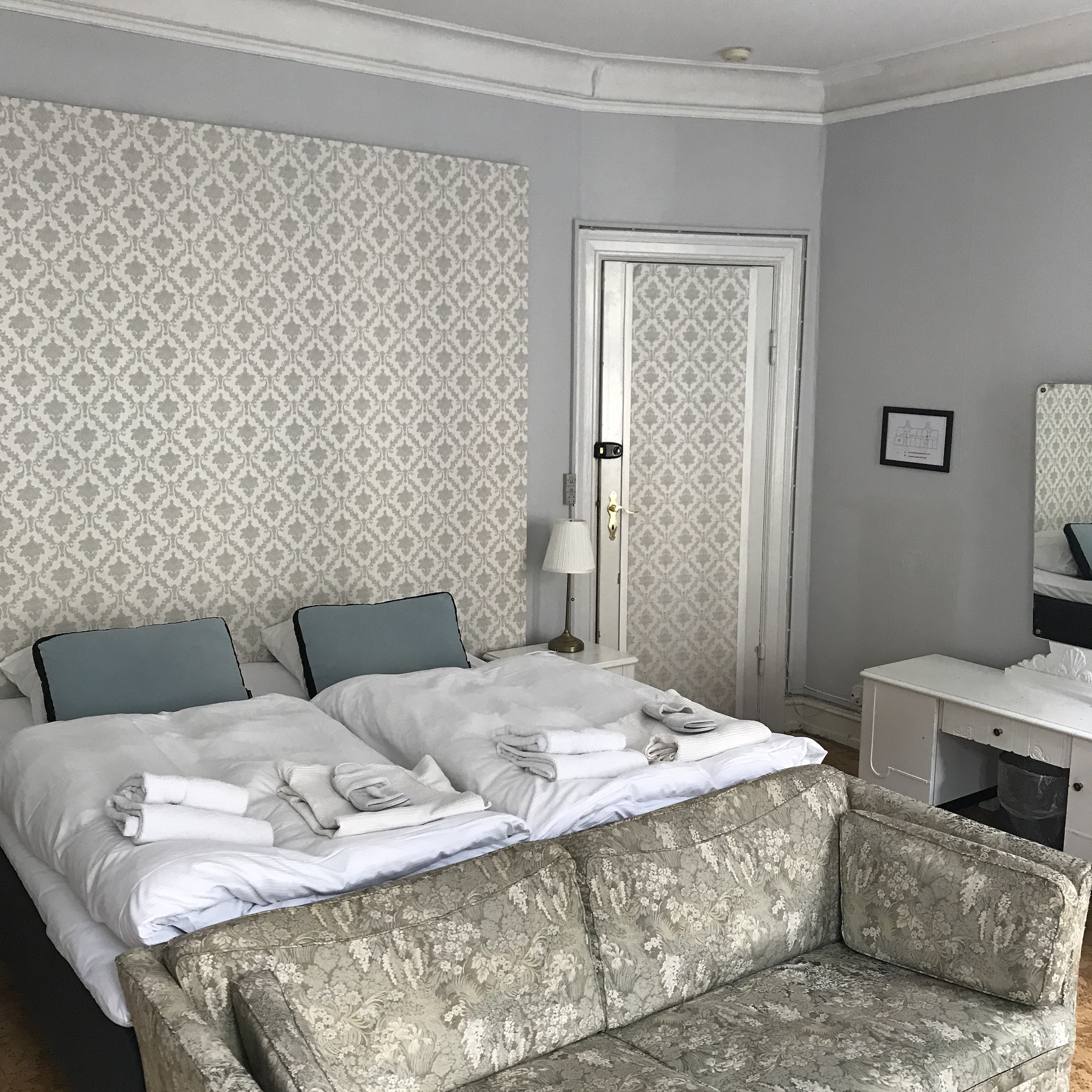 hotel-room-pale-grey-walls-white-bed-copenhagen