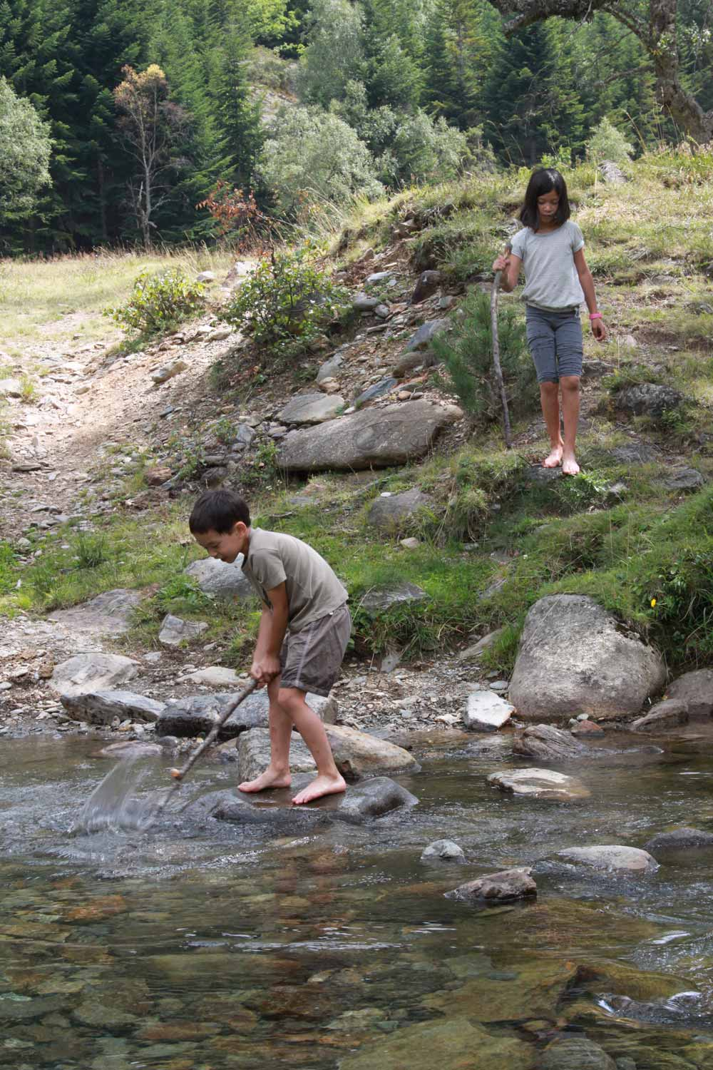 teresa children explore nature stream