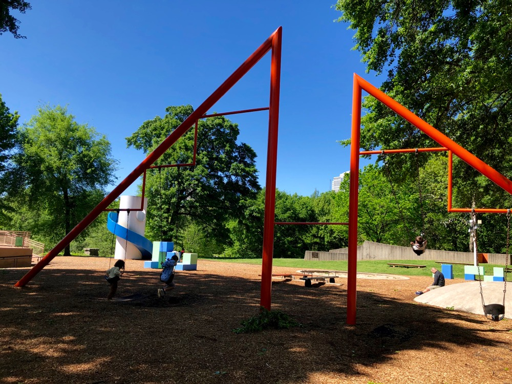 Children on the swings at Noguchi's Playscapes